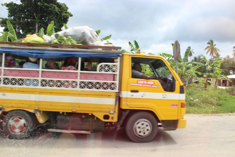 Local taxi transporting people outside of Zanzibar centre