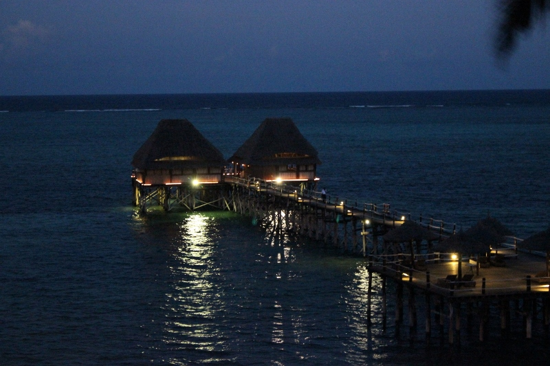 Night time view of the Melia Hotel jetty