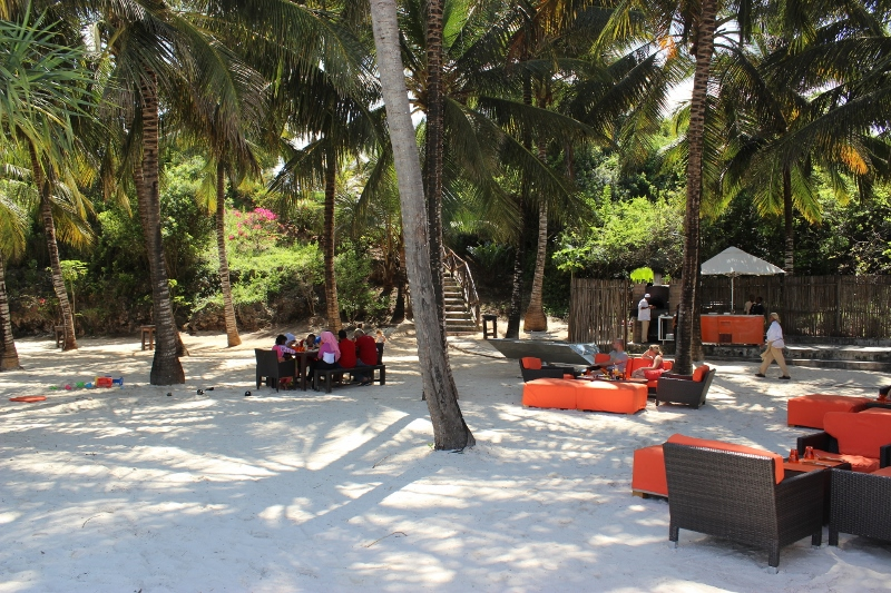 Gabi Beach Restaurant with loungers under the palm trees