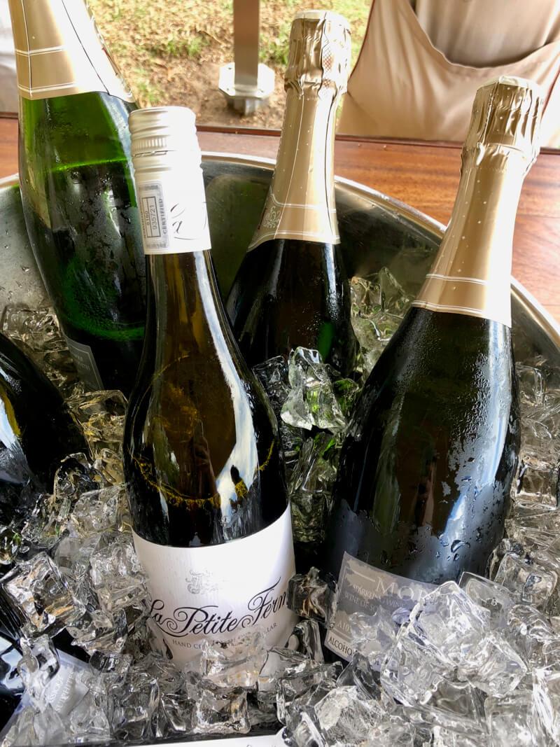 Chilled bottles of wine from La Petite Ferme Franschhoek Wine Farm