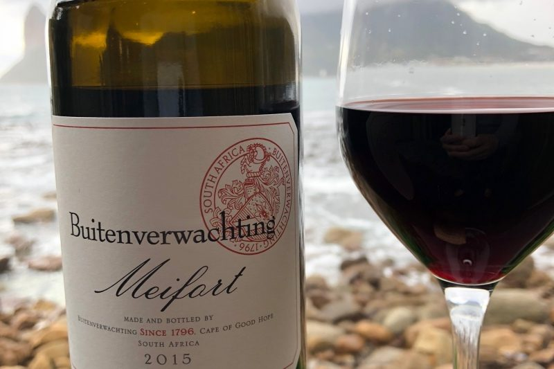 A view of Hout Bay through a bottle of Buitenverwachting Meifort wine