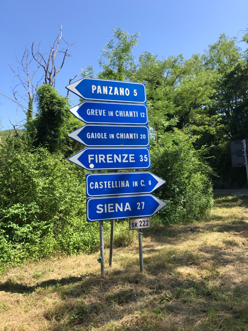 Traffic signs at the cross road while on our way to Querceto di Castellina in Tuscany in Italy