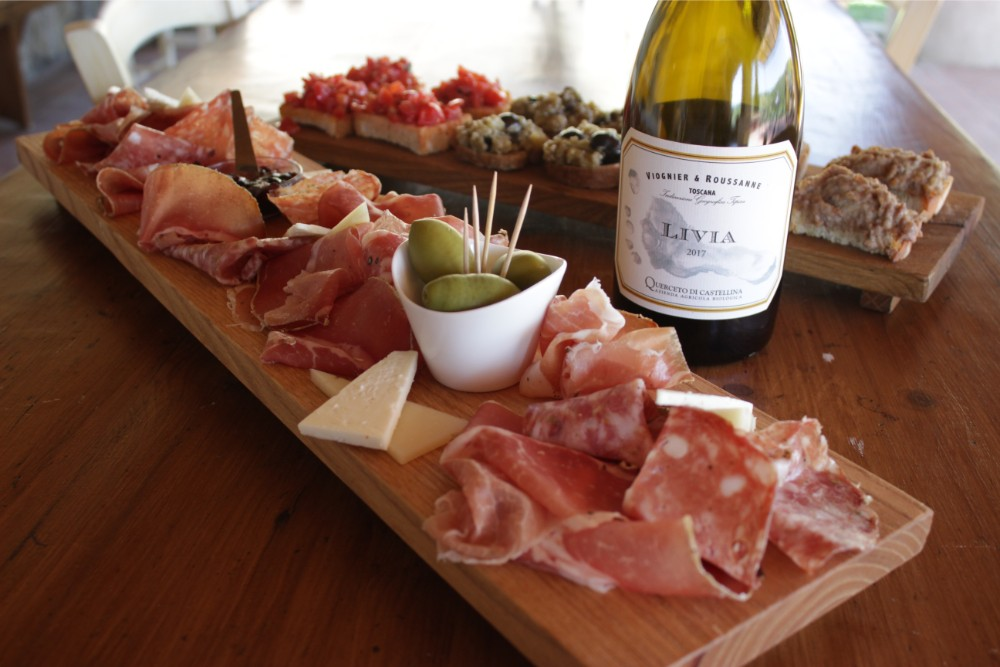 A delicious platter of cured meats paired with a stunning white wine