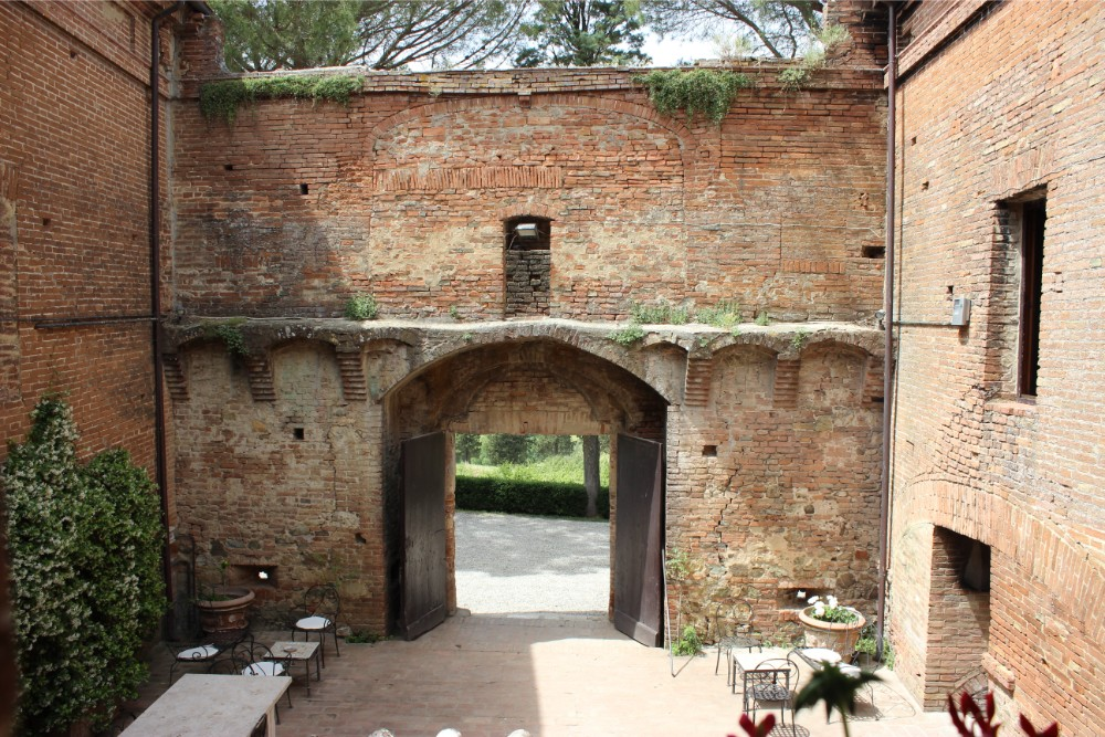Beautiful view looking back at the gated entrance to the medieval castello tricerchi